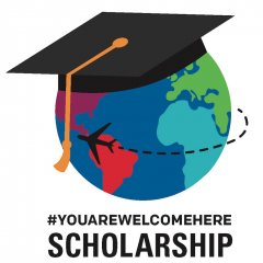 Globe with countries in different colors, a graduate cap on top, and the words #YouAreWelcomeHere Scholarship beneath